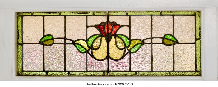 London, UK - 7 February 2018: Original typical Edwardian leaded light window panel with beautiful stained glass above the front door of a residential property