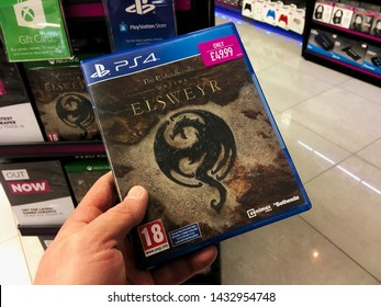 London, UK - 7 June 2019: A hand holding the video game Elder Scrolls Online Elsweyr in a store.