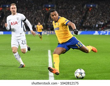 LONDON, UK - 7 MARCH, 2018: Christian Eriksen and Alex Sandro pictured during the UEFA Champions League R16 game between Tottenham Hotspur and Juventus at Wembely Stadium.