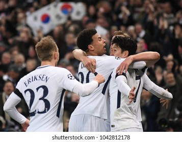 LONDON, UK - 7 MARCH, 2018: Heung-Min Son of Tottenham congratulated by Dele Alli and other teammates during the UEFA Champions League game between Tottenham Hotspur and Juventus at Wembely Stadium.