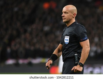 LONDON, UK - 7 MARCH, 2018: Polish FIFA referee Szymon Marciniak pictured during the UEFA Champions League R16 game between Tottenham Hotspur and Juventus at Wembely Stadium.