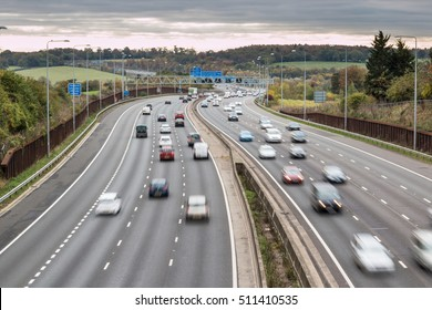 LONDON, UK - 7 NOVEMBER 2016: British M25 motorway in a grey cloudy day