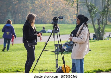 London, UK - 7 November, 2020 - Female film making students shooting video in Alexandra Park