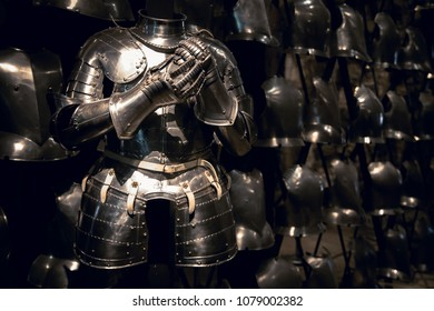London, UK - 7th June 2017: Suit of armour and a display of breastplates in the Armoury of the Tower of London.