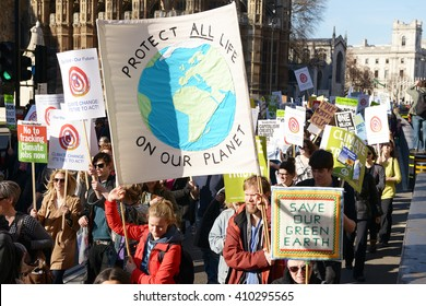 London, UK. 7th March 2015. EDITORIAL - Time To Act -Campaign for Climate Change protesters march through the streets of central London, to urge strong action at the Paris climate conference talks.