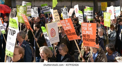 London, UK. 7th March 2015. EDITORIAL -Time To Act - Campaign for climate change protesters march through the streets of central London, to urge strong action at the Paris climate conference talks.