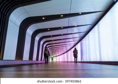 LONDON, UK - 8 MARCH 2017: Commuters walk down a tunnel at Kings Cross  Station