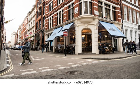 LONDON, UK - 8 MARCH 2017: High Street, Caffe Nero. A branch of the Caffe Nero coffee shop chain on a street corner busy with tourists and locals near Covent Garden, London.