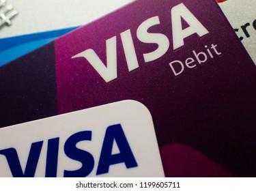 London, UK - 8 October 2018: Close up of a visa debit finance cash logo on a bank account credit card.