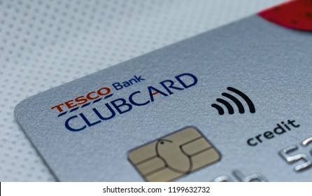 London, UK - 8 October 2018: Close up of a tesco clubcard credit debit loan finance wireless contactless bank card and chip.