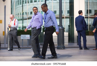 London, UK - 8 September, 2016: London, UK - 8 September, 2016: Business people on the Canary Wharf square, business and financial aria. Modern life concept
