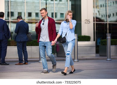 London, UK - 8 September, 2016: Young people walking on the Canary Wharf square, business and financial aria. Modern life concept