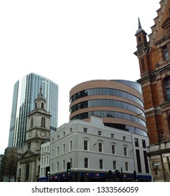 LONDON/ UK- 8th March 2019: Historic and modern buildings stand side by side, along Bishopsgate, in central London's financial district. Including the 12th century, St botolphs church.