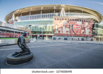 London, UK – 9 December 2017: Thierry Henry bronze statue outside the south Clock End of the Emirates Stadium, North London, home of Arsenal Football Club.
