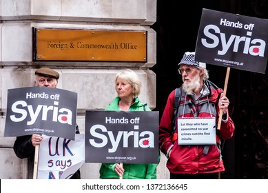 """London, UK - 9 September 2013: protesters hold placards reading 'Hands off Syria"""" during an antiwar demo against military action in Syria."""