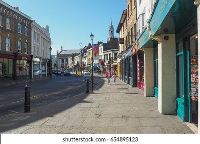 LONDON, UK - 9TH AUGUST 2015: A sunny summer day in the streets of Greenwich, London with unidentified people walking along.