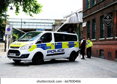 London, UK. 9th June 2017. EDITORIAL - Metropolitan Police officers on high alert in central London, after a recent terrorist attack at Borough Market, police seal off the crime scene area with tape.