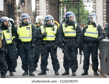 London, UK. 9th June 2018. EDITORIAL - Riot police cordon off a street for public safety during a rally held by supporters of ex EDL leader Tommy Robinson, at Downing Street, Whitehall, London, UK.