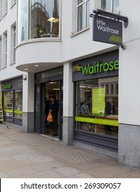 LONDON, UK - 9TH MARCH 2015:  The outside of a Little Waitrose Store in central London. People can be seen.