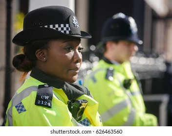 LONDON, UK - Apr 19, 2017: Metropolitan policewoman on duty at 10 St James's Square The Royal Institute of International Affairs Chatham House