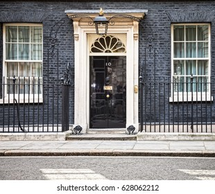 LONDON, UK - Apr 19, 2017: Entrance door of 10 Downing Street in London official residence of First Lord of the Treasury, headquarters of Her Majesty's Government and office of Prime Minister