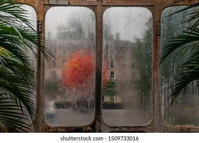 London, UK - Apr 9, 2019 : Beautiful exit door of Palm House at Kew Gardens (Royal Botanic Gardens).