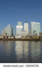 LONDON, UK - APRIL 07, 2015: Canary Wharf skyline, business district banks. Canary Wharf is a major business district located in Tower Hamlets.