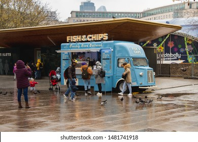London, UK - April 10th 2019: Mobile Fish and Chips shop car near the London Eye at a rainy, typically English day.