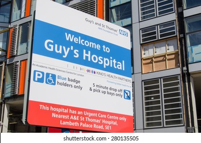 LONDON, UK - APRIL 12, 2015:  A sign at Guy's Hospital in Southwark, inner London.  The National Health Service hospital has many new buildings and is a centre of excellence for healthcare.