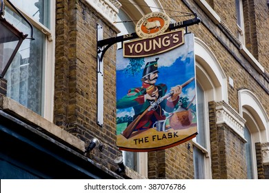 LONDON, UK - April 13, 2015: English pub sign, Public house, known as pub, is focal point of the community