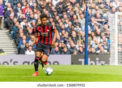 London, UK - April 13 2019: Juninho Bacuna of Huddersfield Town  during the Premier League between Tottenham Hotspur and Huddersfield Town at Tottenham Hotspur Stadium