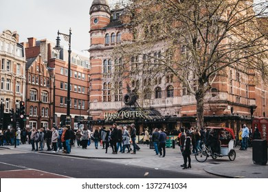 London, UK - April 13, 2019: People walking in front of Harry Potter and the Cursed Child sign at the front of Palace Theatre, London, the first official Harry Potter story to be presented on stage.