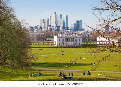 LONDON, UK - APRIL 14, 2015: Canary Wharf view from the Greenwich hill. Modern skyscrapers of banking aria