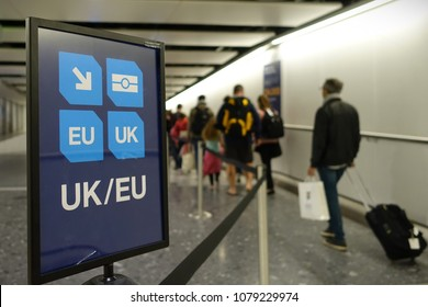 London, UK - April 15, 2018: Air travelers proceed along the UK/EU arrivals lane to passport control at Heathrow airport. The immigration status of EU citizens remains unclear following the Brexit.