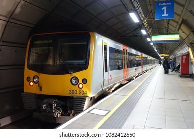 London, UK - April 15, 2018: A Heathrow Express train pulls into Terminal 4 underground railway station at Heathrow Airport.