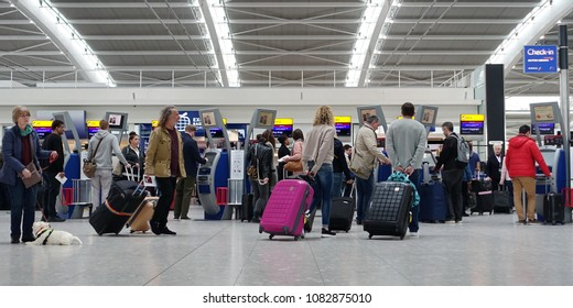 London, UK - April 15, 2018: Air travellers check into flights at Terminal 5 of Heahthrow Airport. Heathrow is one of the busiest airports in the world and busiest in Europe by passenger volume,