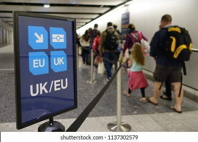 London, UK - April 15, 2018: Air travelers proceed along the UK/EU arrivals lane to passport control at Heathrow airport. The immigration status of EU citizens remains unclear following Brexit.