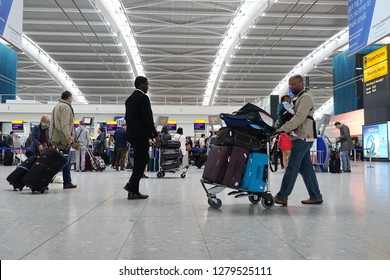 London, UK - April 15, 2018: Air travellers check into flights at Terminal 5 of Heahthrow Airport. Heathrow is one of the busiest airports in the world and busiest in Europe by passenger volume.