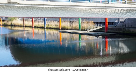 London, UK. April 15th, 2020.  Port on river at the Queen Elizabeth Olympic Park in Stratford. A pile of sticks in different colors.