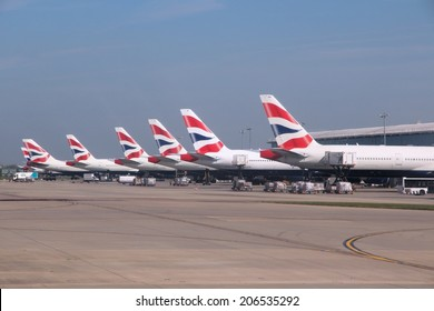 LONDON, UK - APRIL 16, 2014: British Airways Boeing 777s at London Heathrow airport. BA operates fleet of 283 aircraft (largest in the UK) and is largest operator of 747 with 55 aircraft (2014).