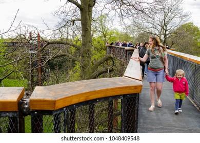 London, UK - April 18, 2014. Treetop Walkway at Kew Botanic Gardens. The walkway allows visitors to walk through 200 metres of forest canopy