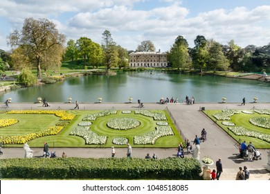London, UK - April 18, 2014. Museum No 1, lake and formal gardens in Kew Royal Botanic Gardens. The gardens were founded in 1840 and are of international significance for botanical research.