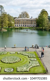 London, UK - April 18, 2014. Museum No 1 and lake in Kew Botanic Gardens. The gardens were founded in 1840 and are of international significance for botanical research and education.
