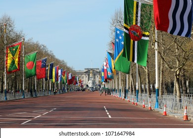 London, UK – April 18 2018: Flags of Commonwealth states along The Mall in central London, with Buckingham Palace in the distance, on the occasion of the Commonwealth Heads of Government meeting