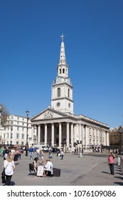 LONDON, UK - APRIL 19, 2018: Exterior view of St-Martin-in-the-Fields church on a sunny day with tourists in Trafalgar Square, London