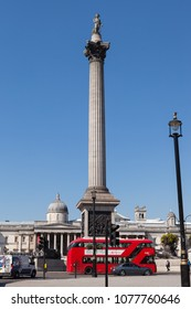 LONDON, UK - APRIL 19, 2018: View of Nelson's Column with red bus seen from the south of Trafalgar Square in London.