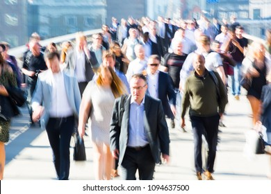London, UK - April 19, 2018: Blurred image of office workers crossing the London bridge in early morning on the way to the City of London, the leading business and financial area in Europe. Rush hours