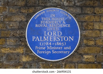 LONDON, UK - APRIL 1ST 2015: A blue plaque marking the former residence of former British Prime Minister Lord Palmerstone in Piccadilly, London on 1st April 2015.