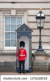London, UK - April 20, 2019: Buckingham Palace, London, Great Britain. A palace guard outside the palace.