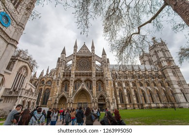 London, UK - April 2014: Tourists crowd in front of Westminster Abbey on a cloudy afternoon